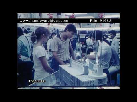 Tourists buying a Sony Walkman in a Singapore Electronics shop, 1982.  Archive film 91985