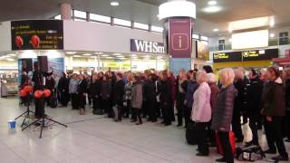 Rock Choir Flash Mob - Gatwick Airport, Give a Little Respect