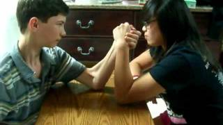 Repeat youtube video Girl beats boy in arm wrestling Super funny hilarious!!!!