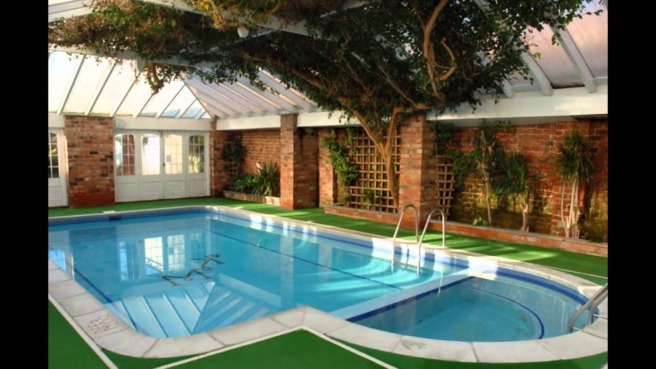 Indoor residential swimming pools house plans indoor for Pool house building costs