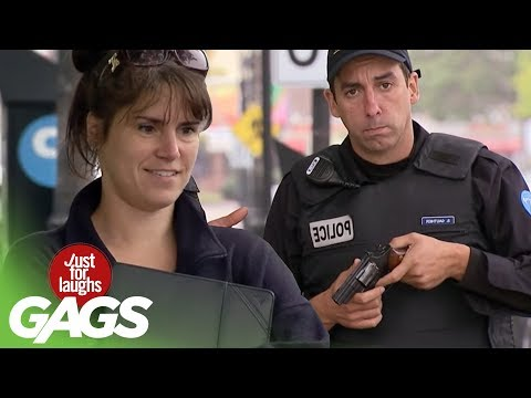 Cop Shoots Himself in the Foot with Gun Prank! - Just For Laughs Gags