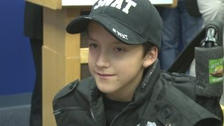 Sick child sworn in as APD SWAT Officer