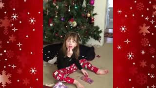 Cat surprises 3 year old girl for Christmas!