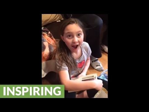 Little girl learns she'll be a big sister