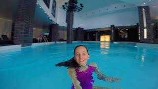 Swimming underwater in an indoor swimming pool