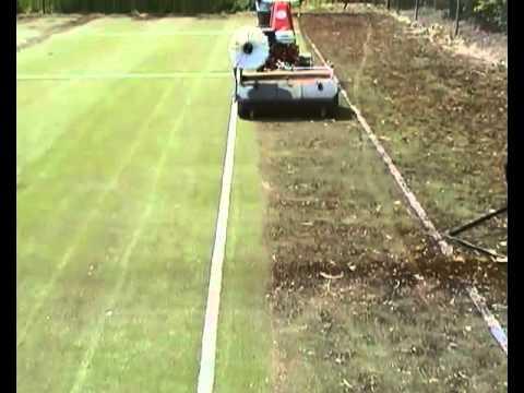 Kersten K 2100 sweeping a tennis court