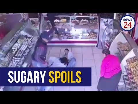 WATCH: Woman shields children from would-be bakery robbers