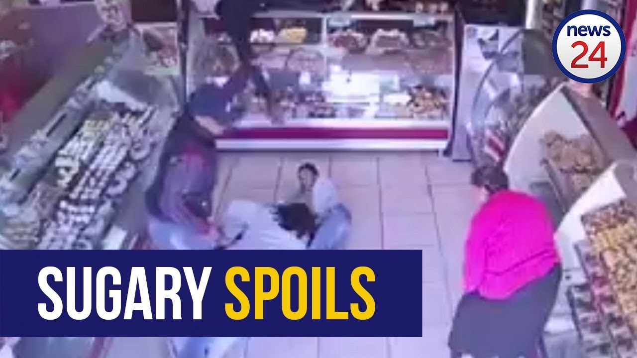 Video shows how a mother shields her child during bakery robbery