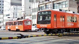 伊予鉄道ダイヤモンドクロスを通過する坊ちゃん列車,モハ50形,モハ2000形,モハ2100形,700系,610系,3000系 thumbnail
