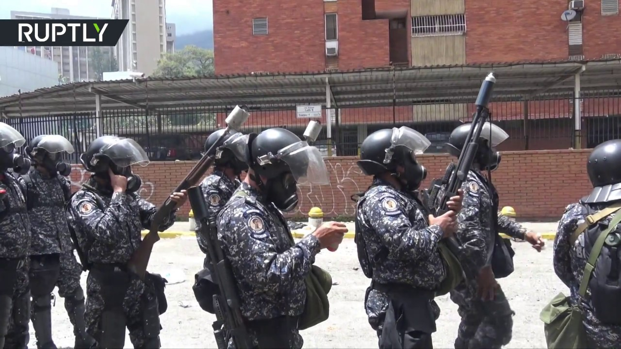 Months of chaos: Protesters clash with Caracas police after attempt to storm TV network offices