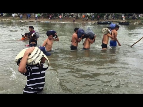 Migrants cross Suchiate river into Mexico