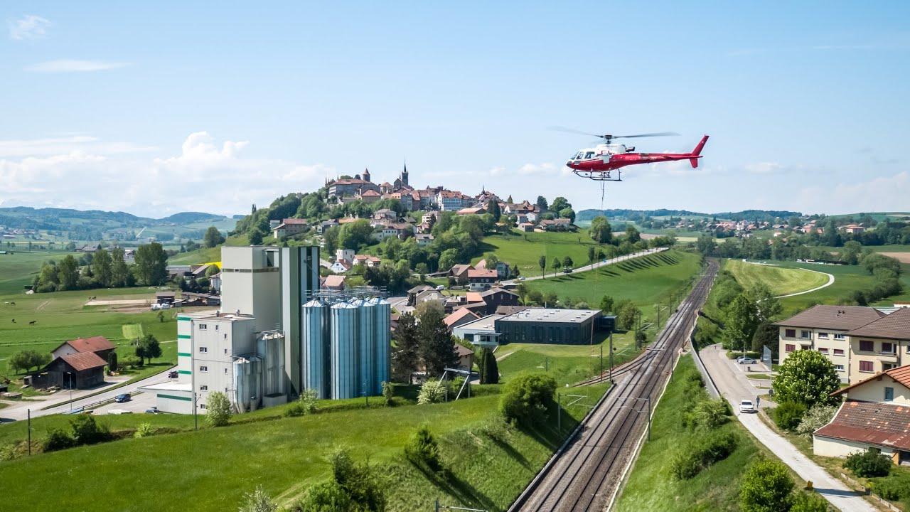 SWISS-FLY BORIS BRON - CFF - Romont - Mise en place des mâts par hélicoptère.