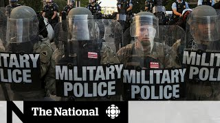 Trump threatens to deploy military to end protests