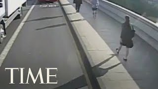 Police Footage Shows Jogger Pushing Woman Into The Path Of A Bus On Busy Road In London | TIME thumbnail