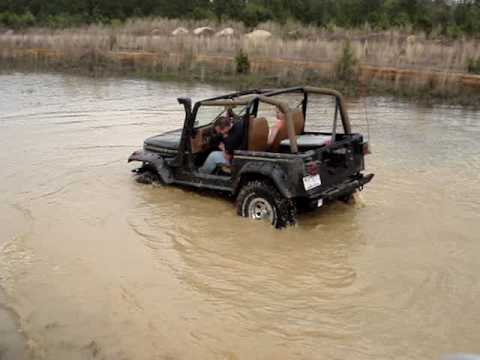 1994 lifted 4 cylinder jeep wrangler yj in water  YouTube