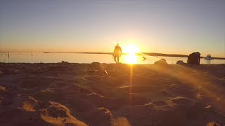 Sunrise over grand traverse west bay, snorkeling, and treasure hunting (interesting finds) beautiful