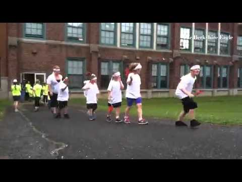 """The """"countries"""" enter for the C.T. Plunkett Elementary School Olympic Games field day in Adams. @ber"""
