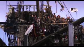 geoffrey rush as captain barbossa on the deck of the mystery ghost ship silent mary