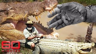 Man rides giant crocodiles even after they bit off his hand | 60 Minutes Australia