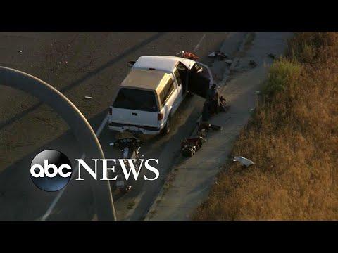 Police investigating motive in deadly rush hour traffic stop gun battle