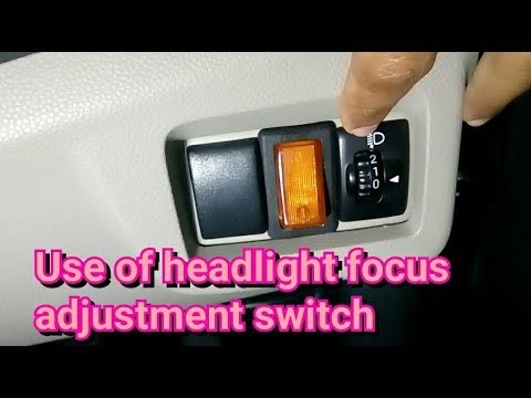 How to adjust headlights beam by this switch?
