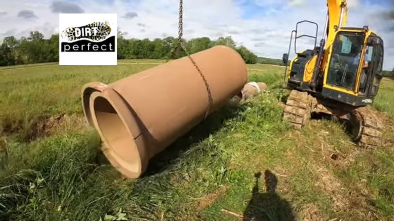 Installing large clay culvert Pipe for Farmer Chris with the hx145  LCRHyundai Excavator
