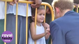 Little girl offers Prince Harry her drawing in Saint Kitts and Nevis