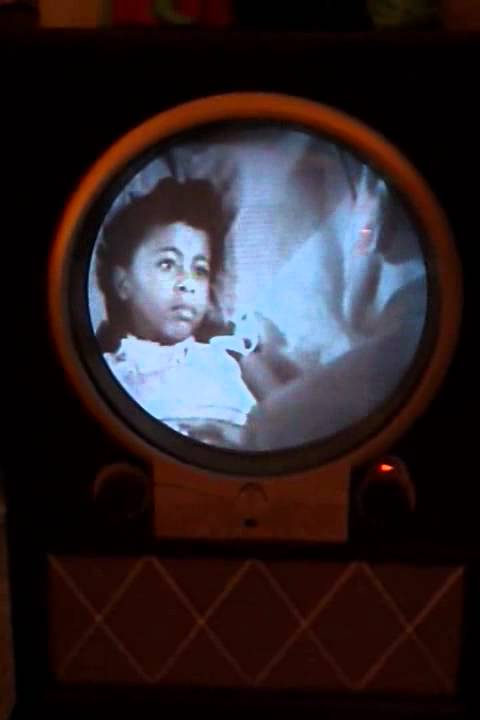 Zenith Porthole TV playing Amos N Andy Christmas Story - YouTube