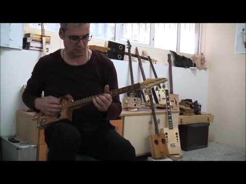 cigar box guitar, norwegian wood cover