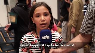A young girl becomes very emotional as she presents...