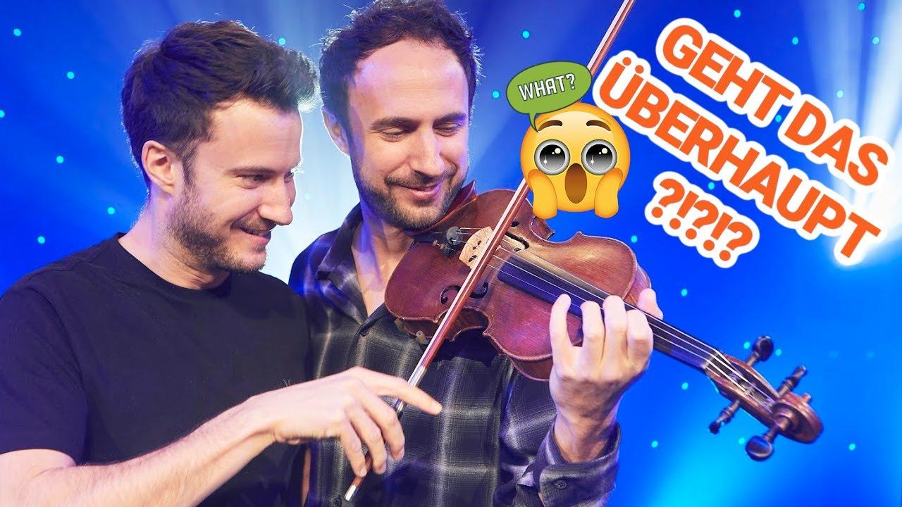 Zwei Brüder spielen auf einer Geige 🎻 😯