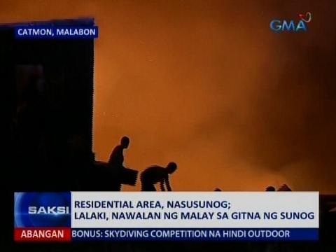 Saksi: Residential area sa Malabon City, nasunog; lalaki, nawalan ng malay sa gitna ng sunog
