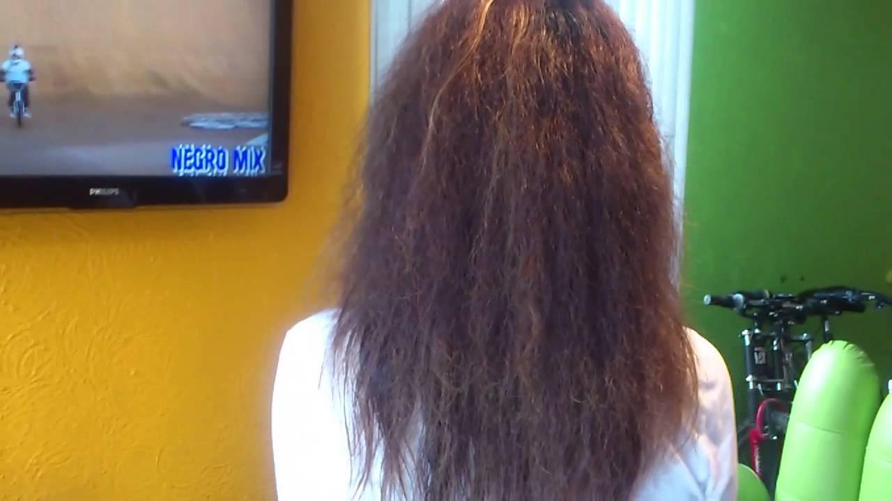 Como quitar volumen a pelo rizado
