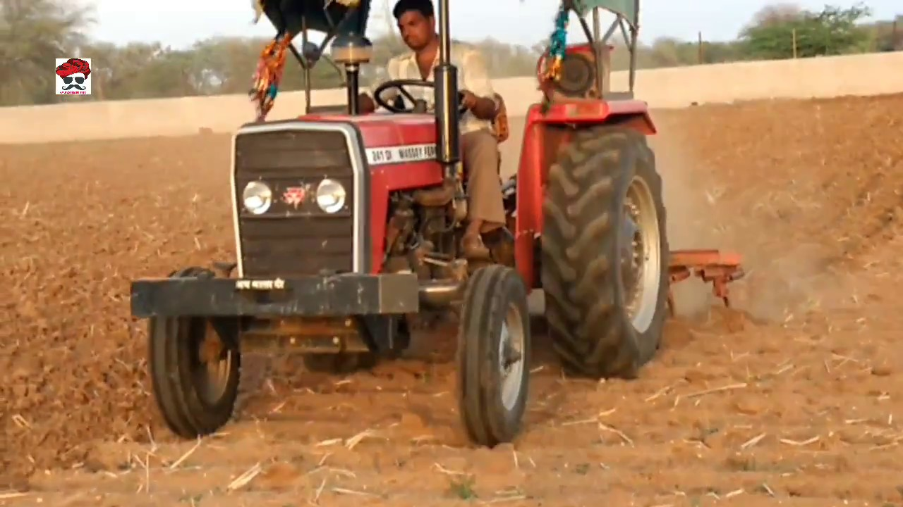 Massey tractor working land and top down Cultivater in ...