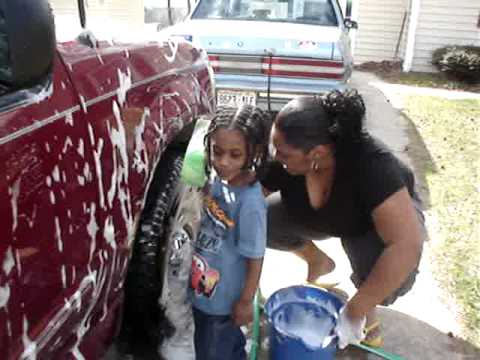 Jess and Connor washing the Car