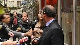François Hollande interpellé par deux Femen