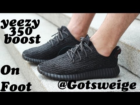 Yeezy 350 Boost in Black by Kanye West on foot