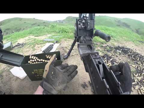 Marines firing a pair of M240B machine guns