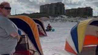Tourists hit the beach despite virus spread fears