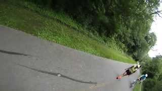 Lady almost hits cyclist while day-dreaming.