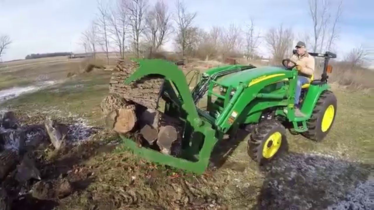 John Deere 3320 With A Titan 60 Quot Grapple Youtube