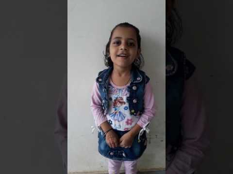 Little cute girl singing bajan bam bam bola chade bhang ka gola