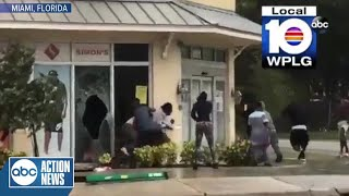 Looters caught on camera breaking into a store in Miami