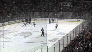Torrey Mitchell jumps over Dan Boyle's goal