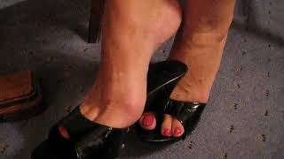 MATURE FEET TRYING ON TWO PAIRS OF HIGH HEELED MULES