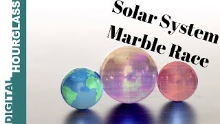 I use miniature 3D printed Solar System marbles to create this race...