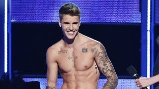 Justin Bieber Strips & Gets Booed at at Fashion Rocks 2014 NYFW