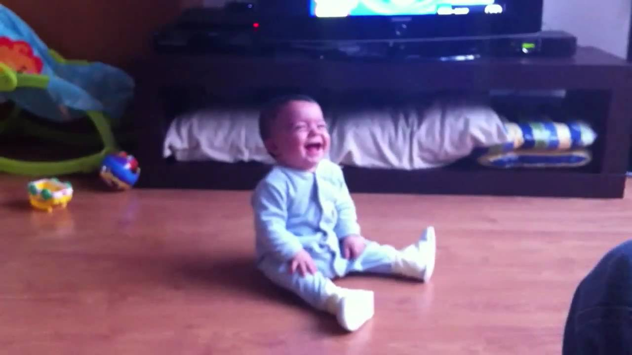 Funny video of a baby laughing out loud with a bouncing ball