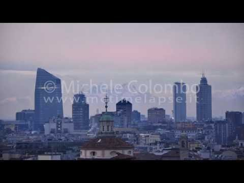 0035 - time lapse - Skyscrapers over mountains in Milan, sunset