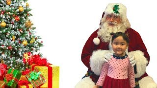 Semra meets with Santa for the first time.